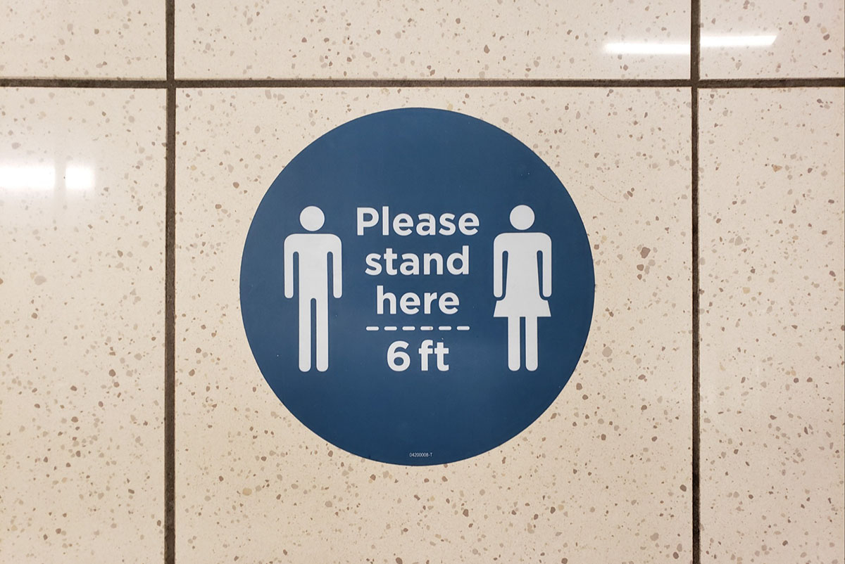 a social distance floor sticker